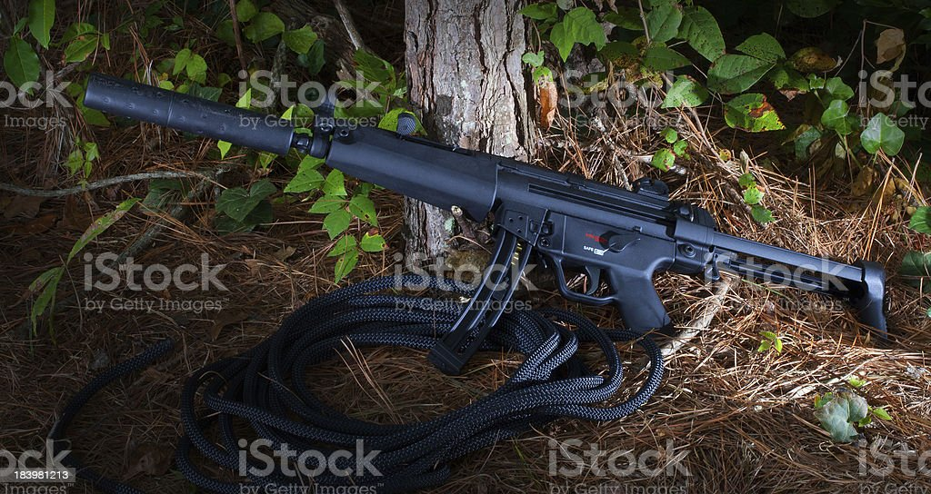 Suppressed firearm stock photo