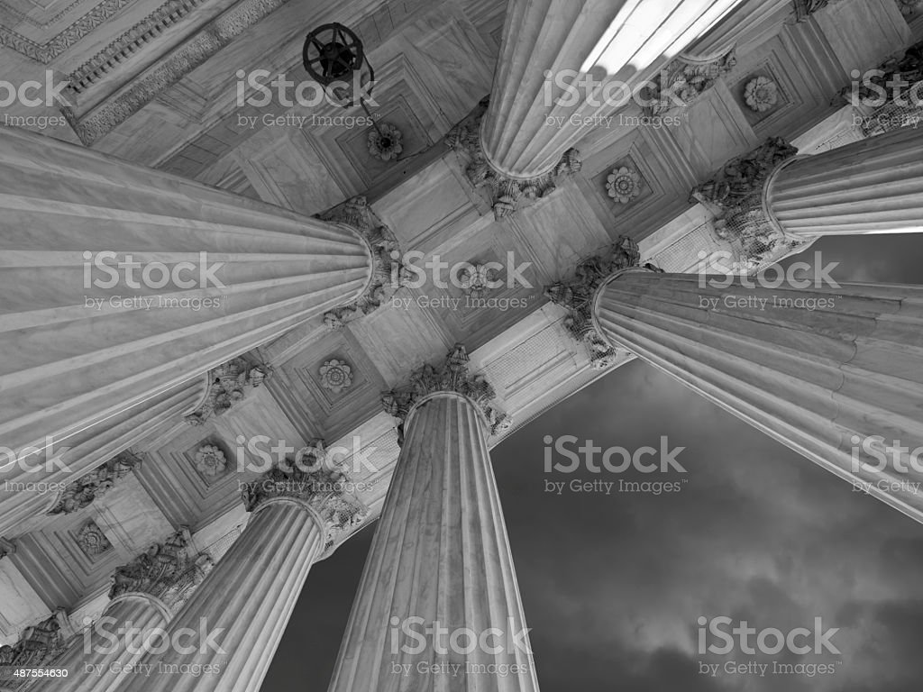 US Supreme Court Columns and Storm in Black and White stock photo