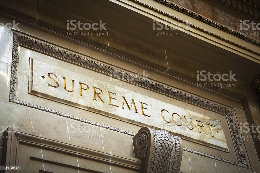 USA Supreme Court Marble Entrance Sign for Legal System Justice stock photo