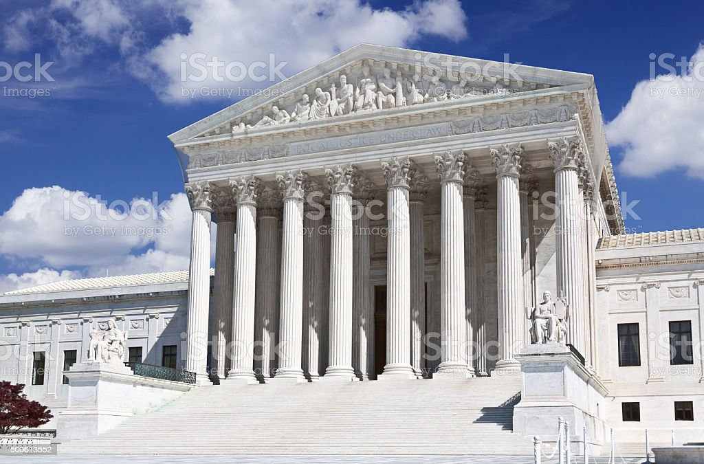 US Supreme Court, Washington DC. Blue sky, clouds. stock photo