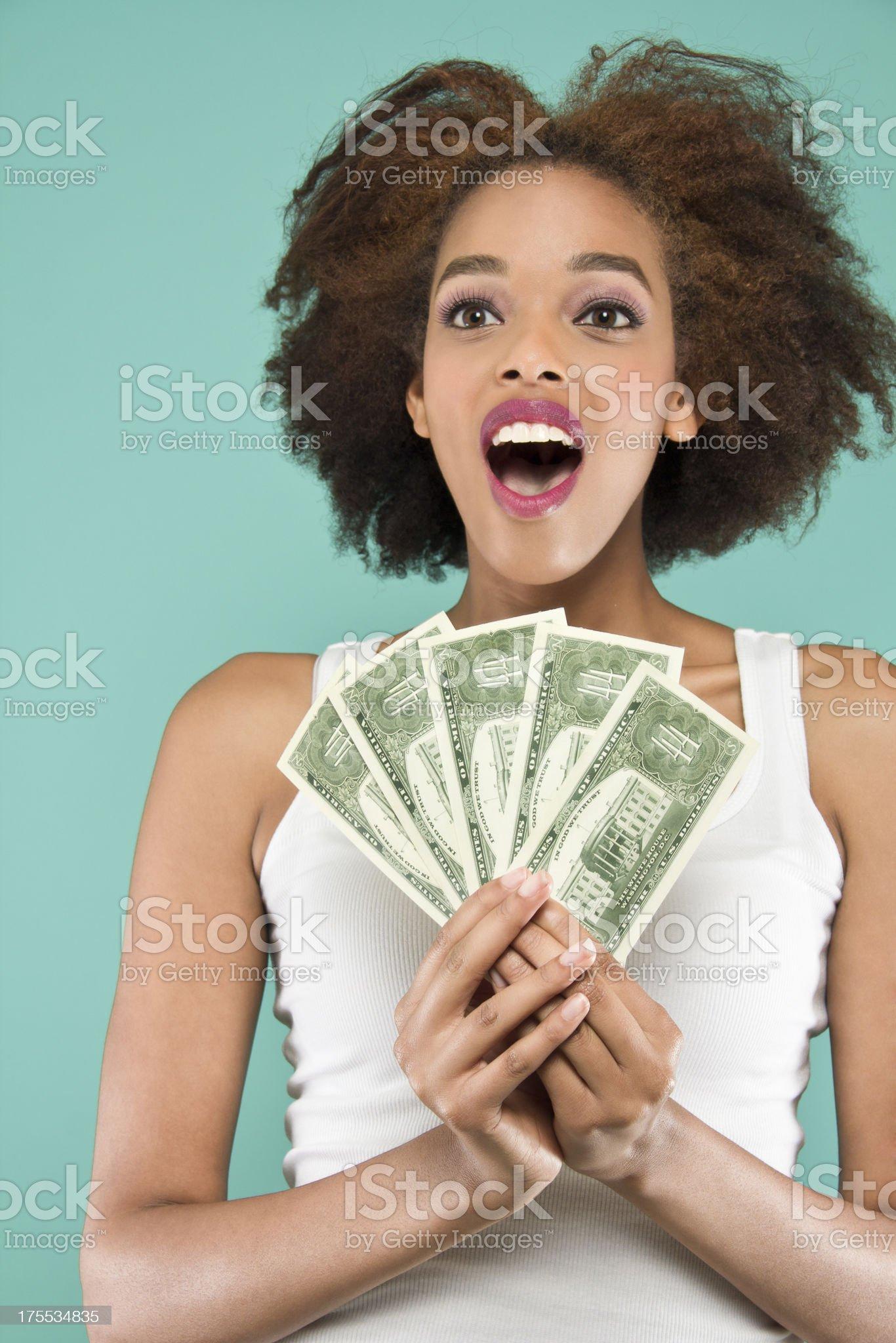 Suprised Holding Money royalty-free stock photo