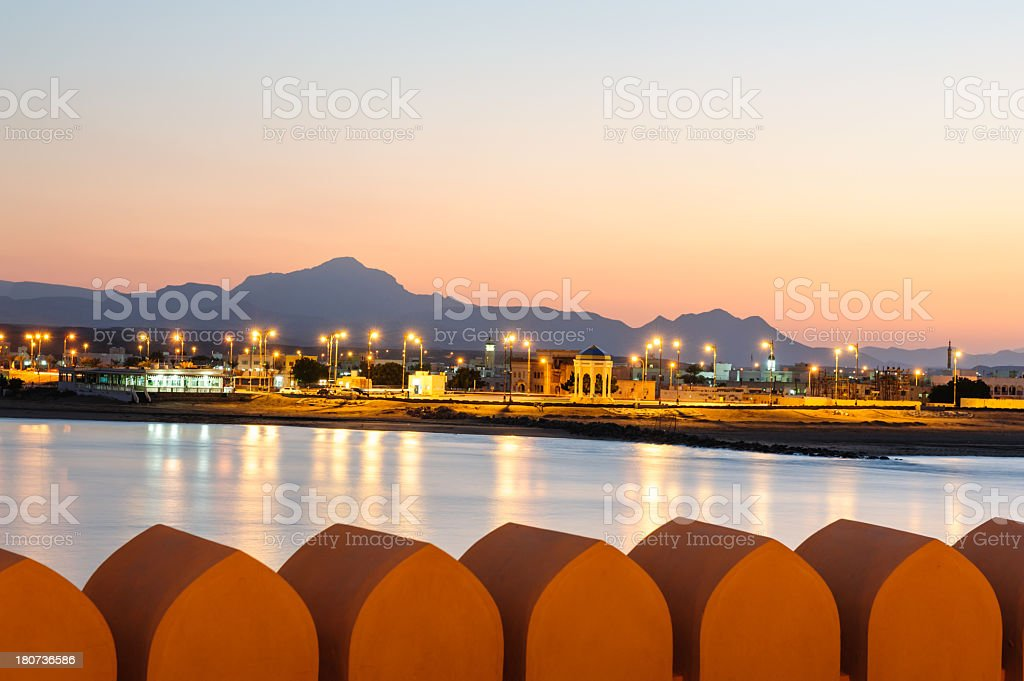 Sur city at Oman coastline with city lights stock photo