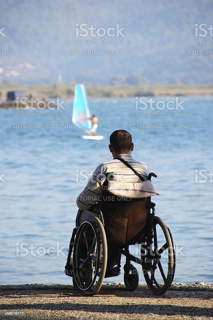 Surf and a man in wheelchairs stock photo