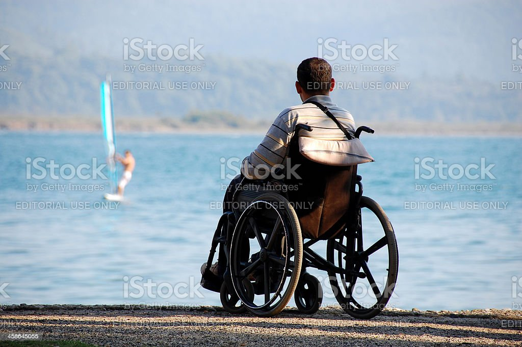Surf and a men in wheelchairs stock photo