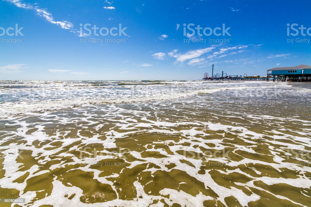 Surf and Sand with Carnival on Pier. stock photo