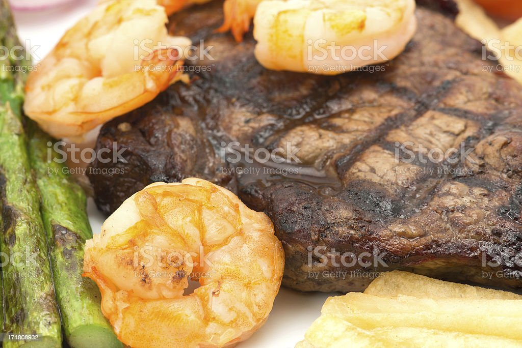 Surf and turf beef steak dinner - close up royalty-free stock photo
