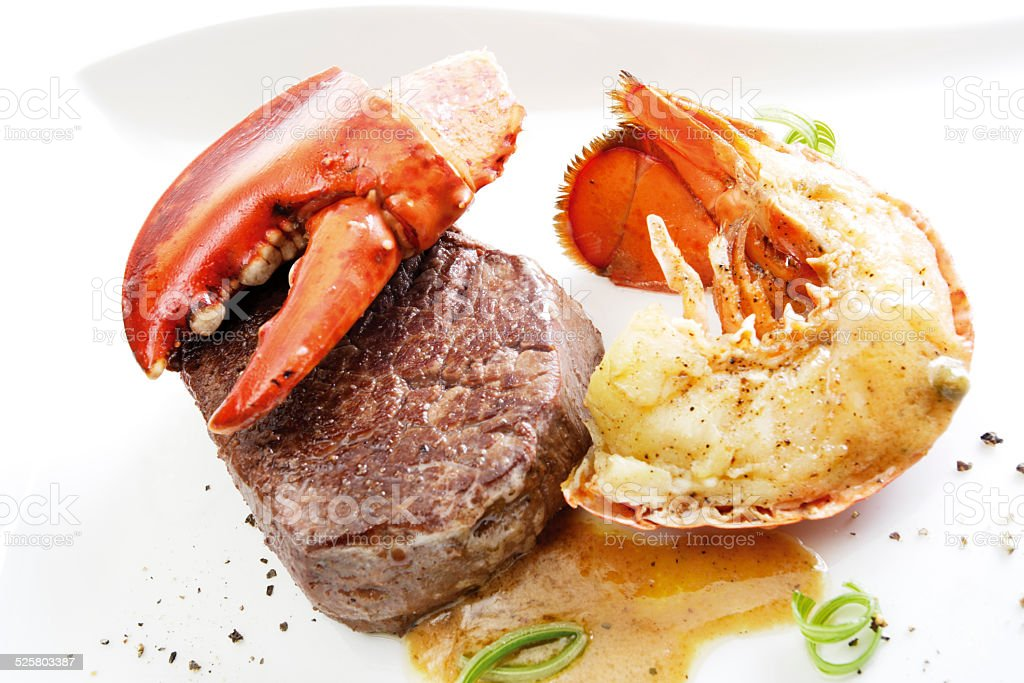 Surf and turf filet steak with seafood stock photo