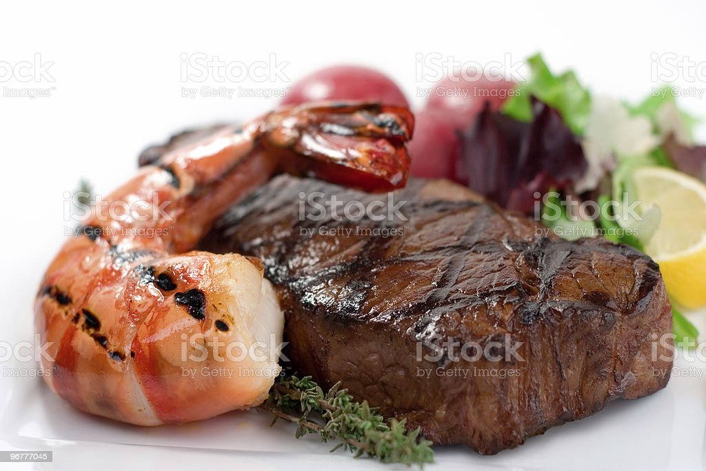 Surf and turf seafood dinner on plate stock photo