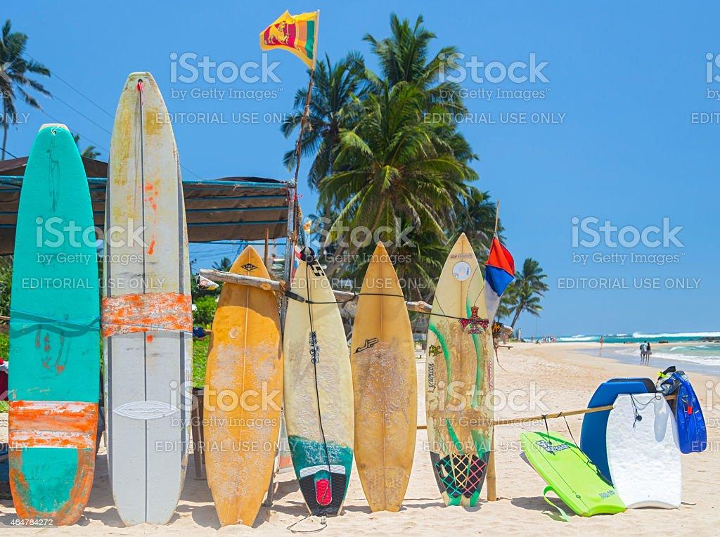 Surf boards on sandy Weligama beach in Sri Lanka stock photo