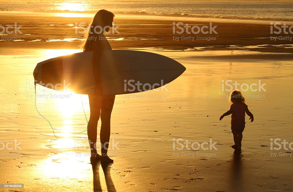 Surf mama with a baby stock photo