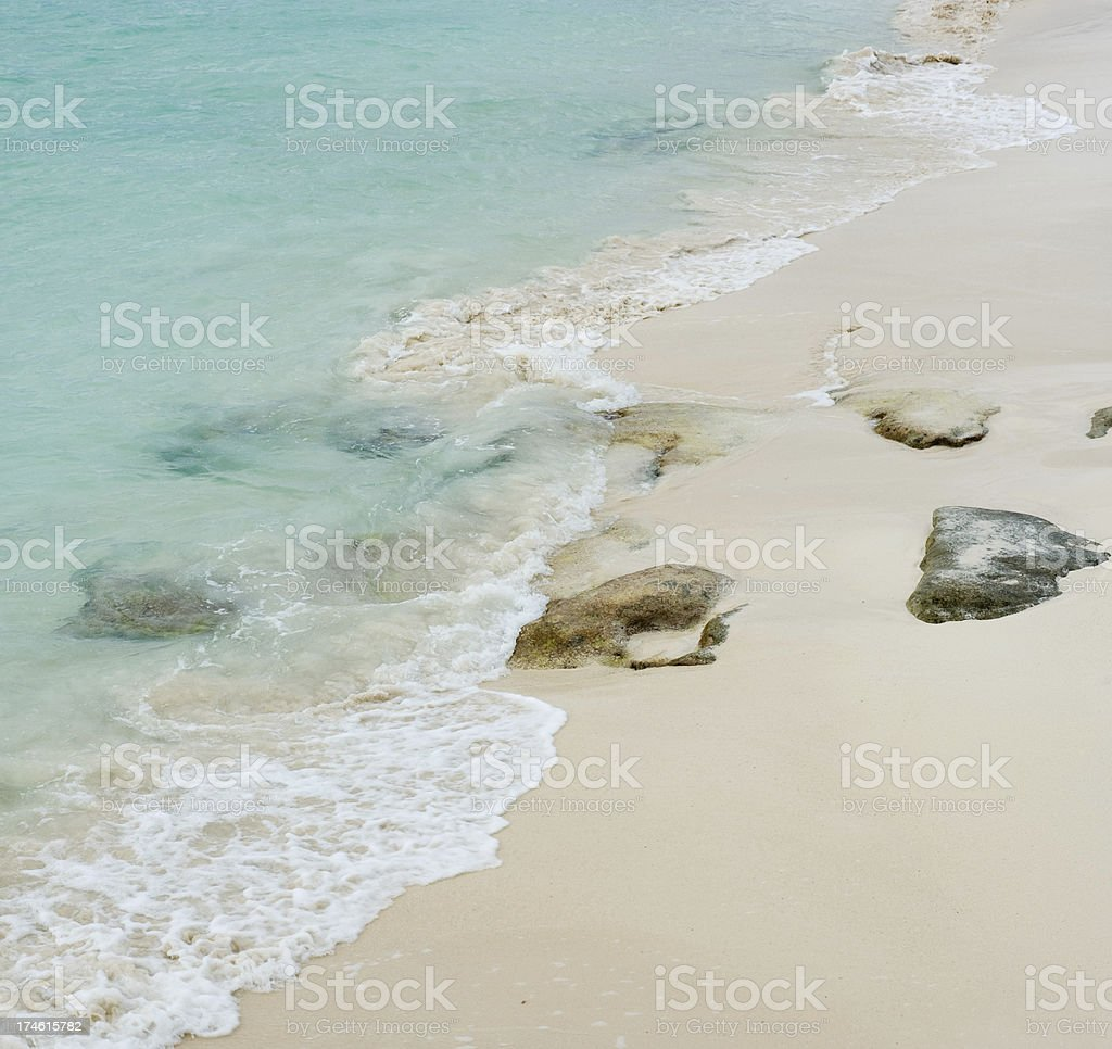 Surf, Sand and Rocks royalty-free stock photo