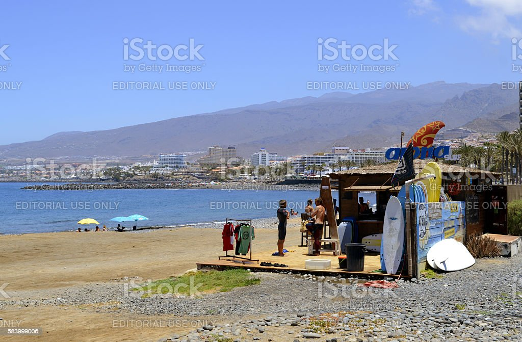 Surf shack with surfers and surf boards on the beach stock photo