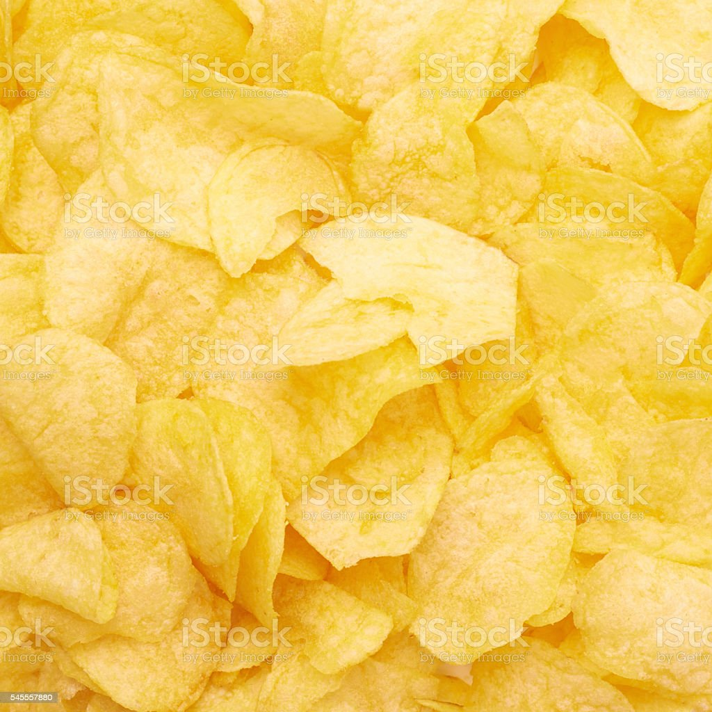 Surface covered with potato chips stock photo