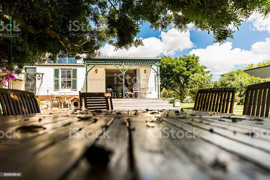 Surface level of table with house in background stock photo