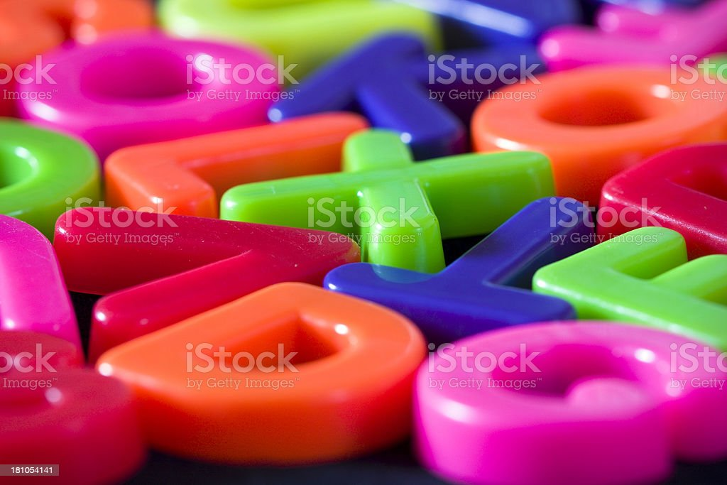 Surface level view of multicolored plastic alphabet letters. stock photo