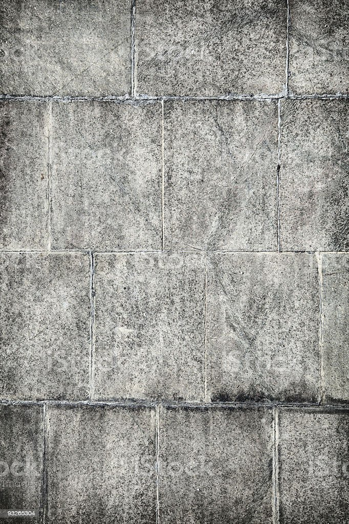 Surface of old concrete wall covered with grey plates stock photo
