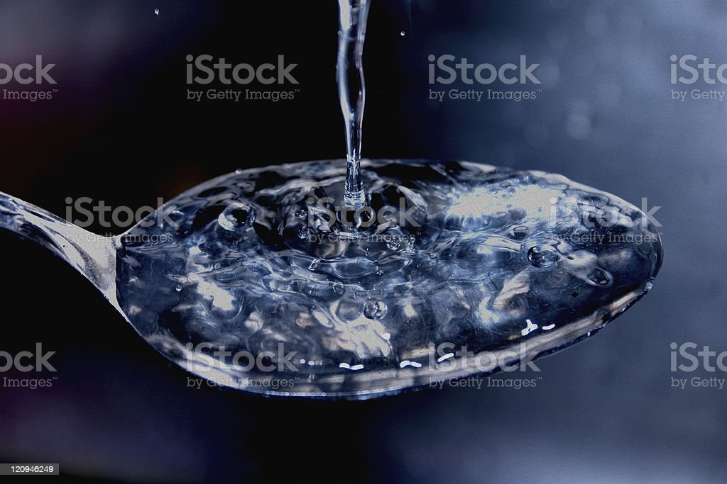Surface Tension of Water - Spoon stock photo