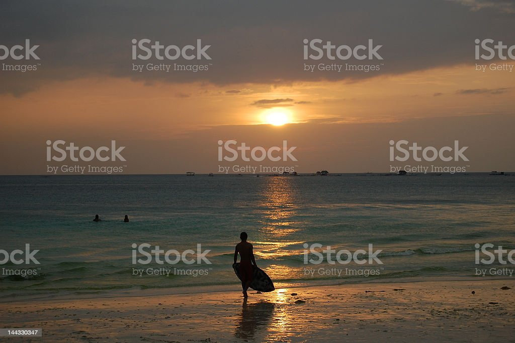 surfboard and sunset royalty-free stock photo