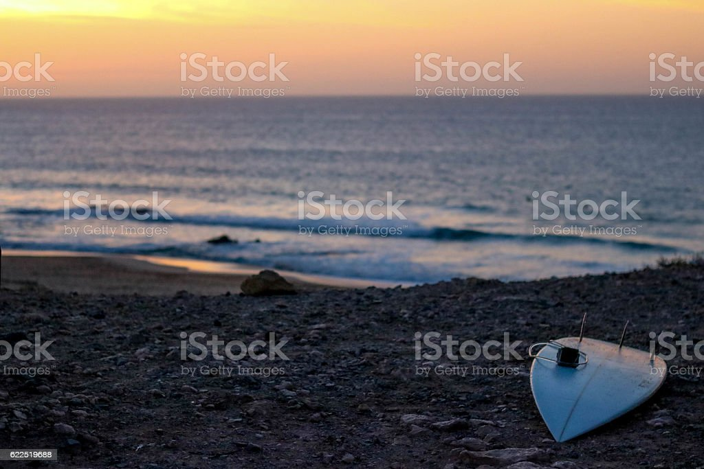Surfboard and the sunset stock photo