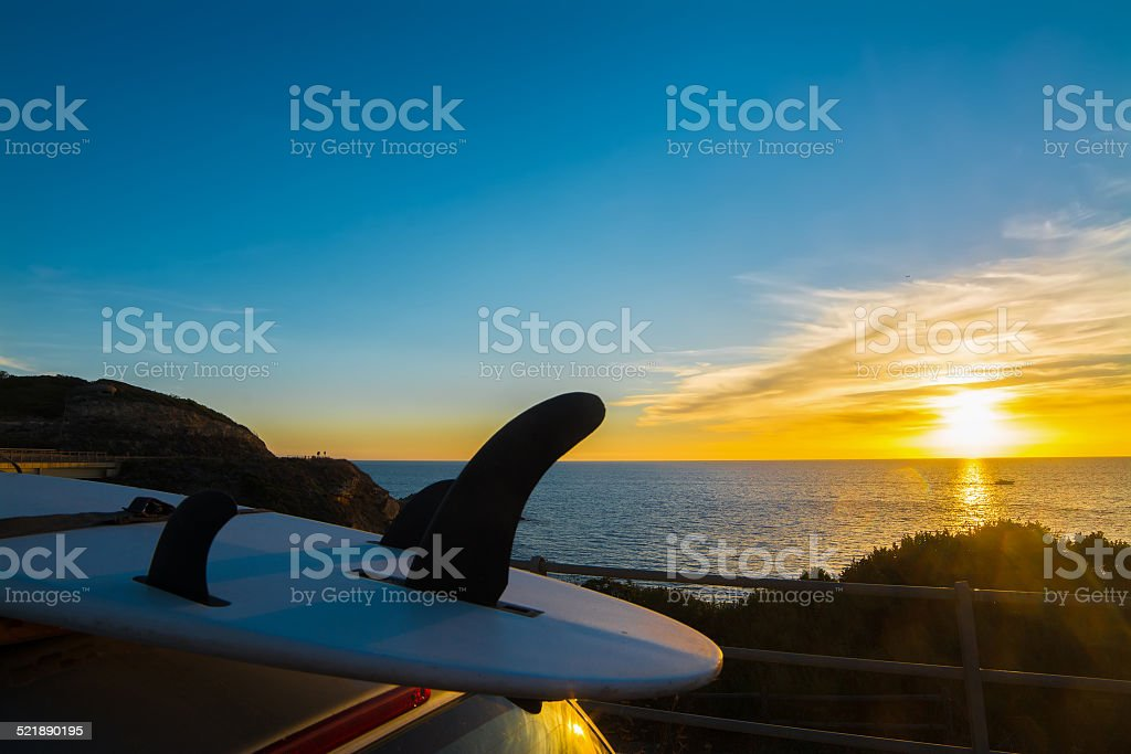 surfboard at dusk stock photo