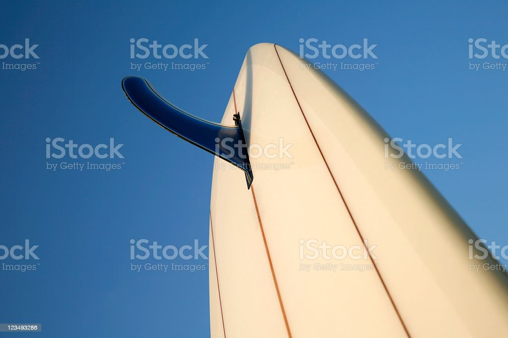 surfboard fin with blue sky background stock photo