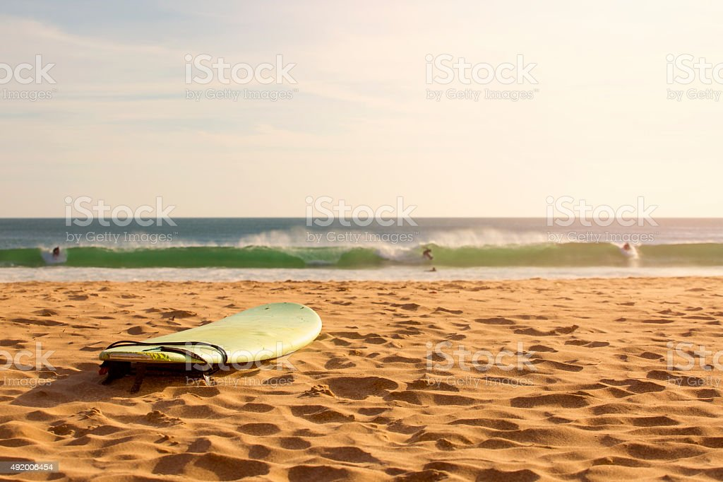 surfboard in the sand on the beach stock photo
