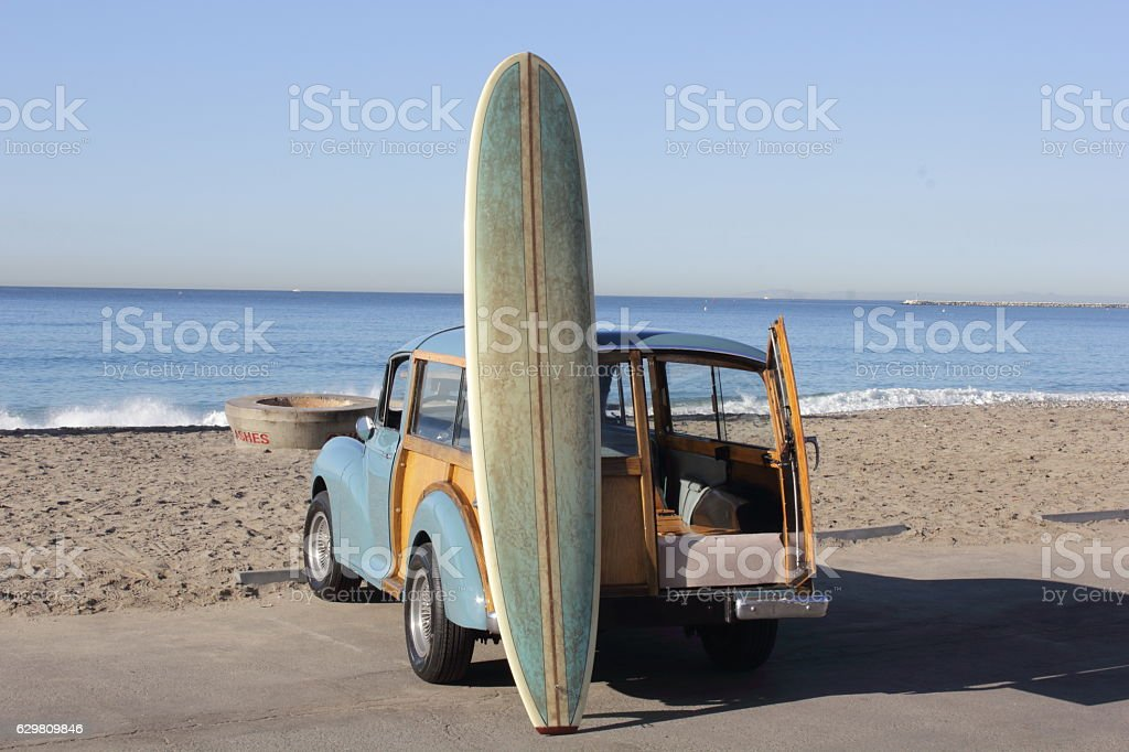 Surfboard Leaning on a Woody at the Beach stock photo