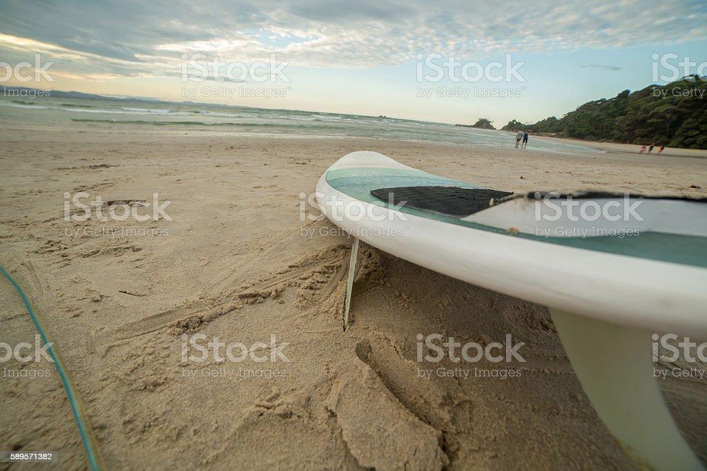 Surfboard on beach, Byron Bay stock photo