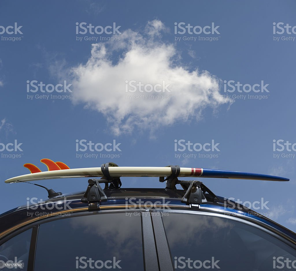 Surfboard on car roof stock photo