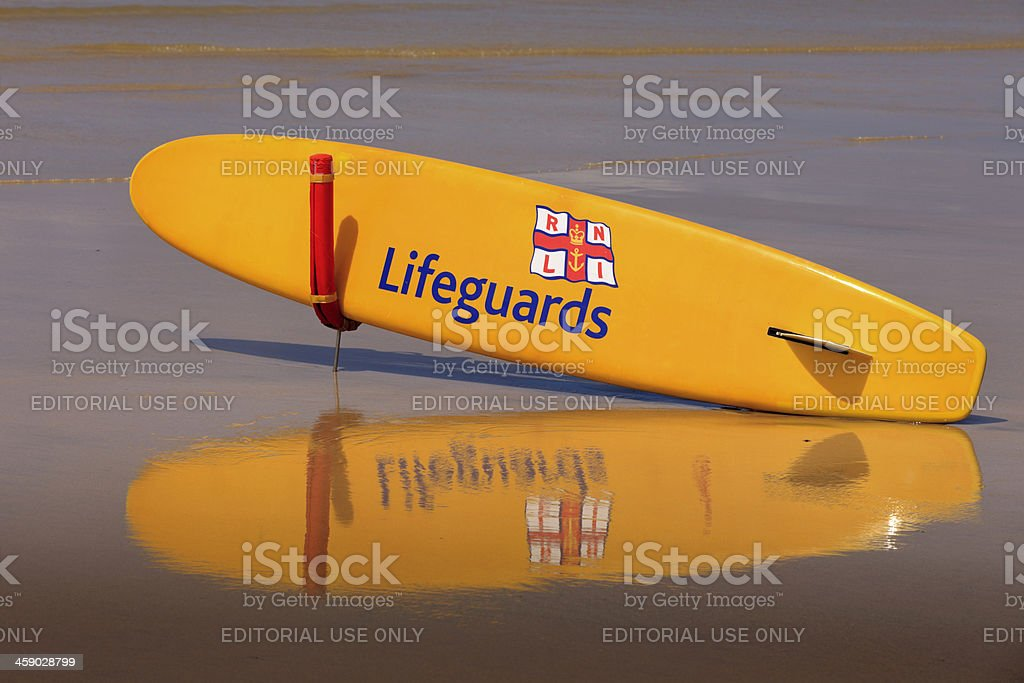 RNLI surfboard on the beach at Gwithian stock photo