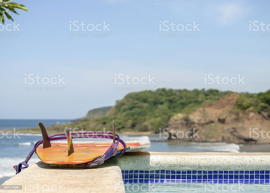 Surfboard over clif stock photo