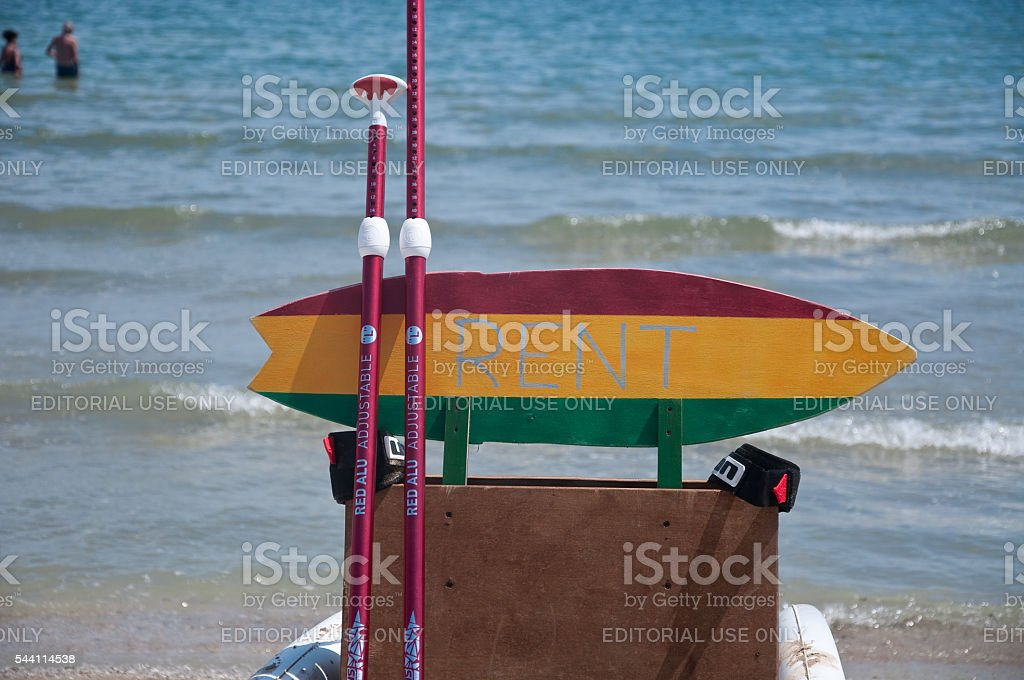 surfboard used as a sign for bicycle rent stock photo