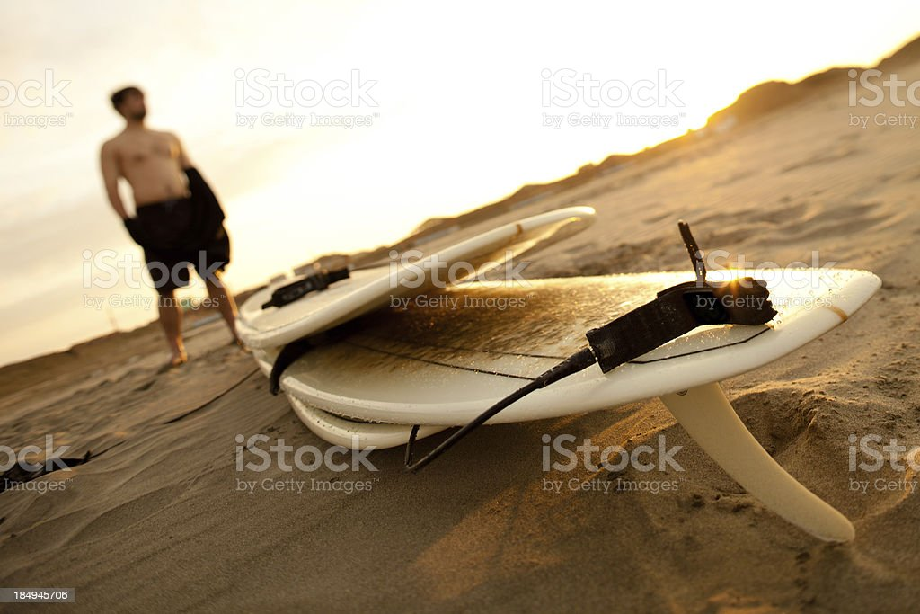 Surfboards reflecting the sunset stock photo