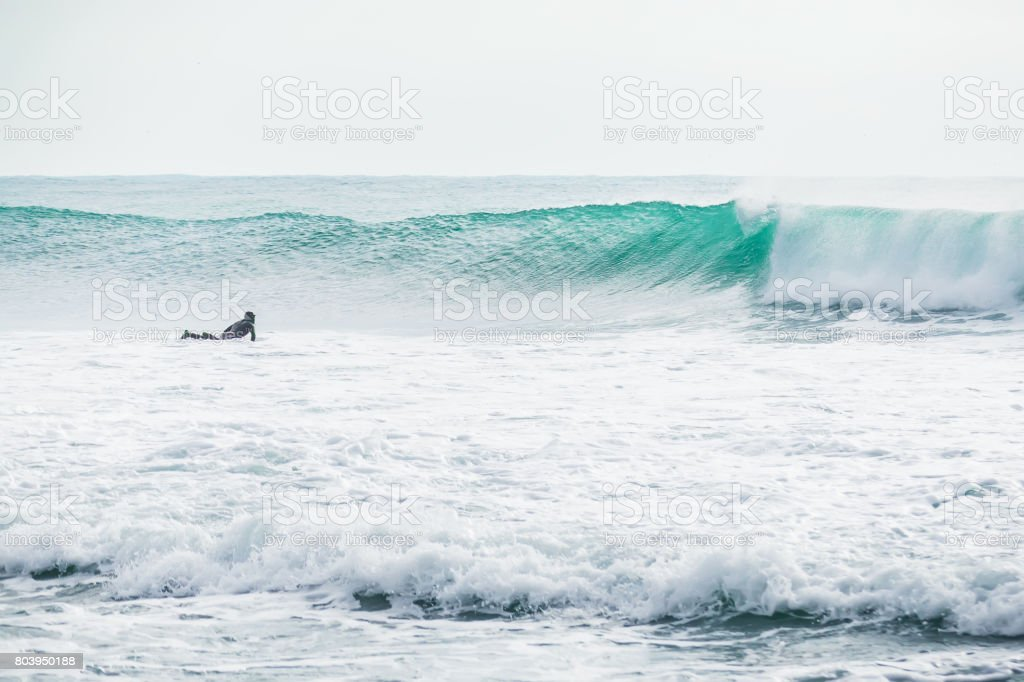 Surfer and beautiful blue wave in ocean. stock photo