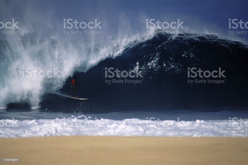 Surfer at big Pipeline, Oahu stock photo