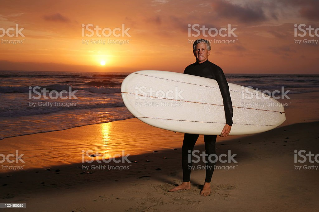 surfer at sunset royalty-free stock photo