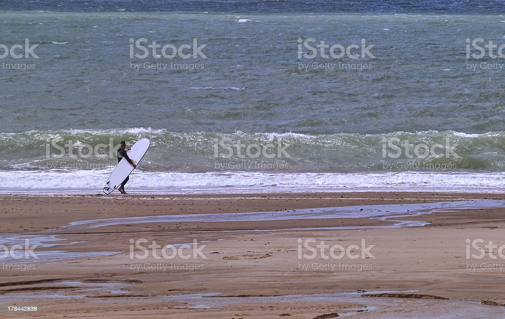 Surfer at the beach royalty-free stock photo