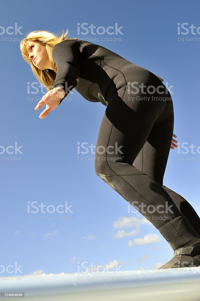 Surfer Balancing on a Surfboard stock photo