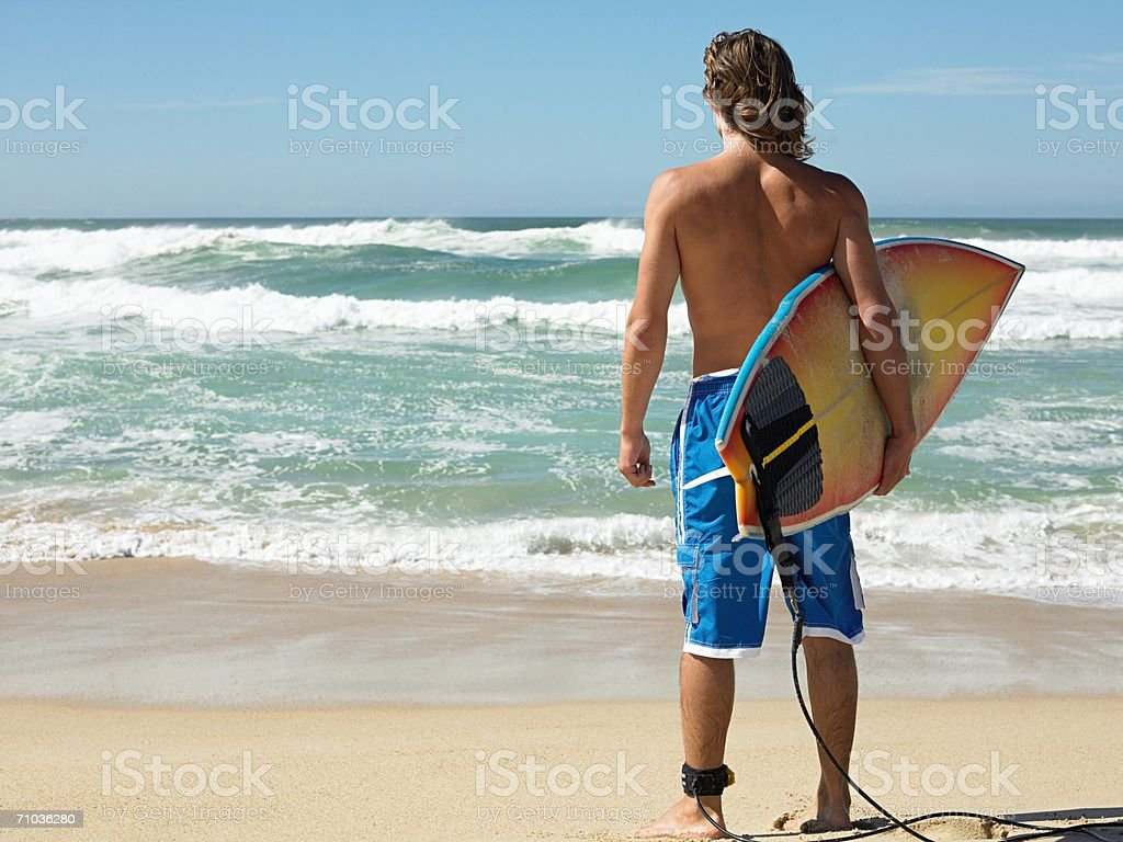 Surfer by the sea stock photo