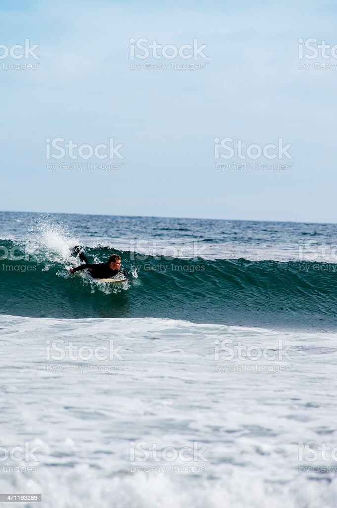 Surfer Catching a Wave royalty-free stock photo