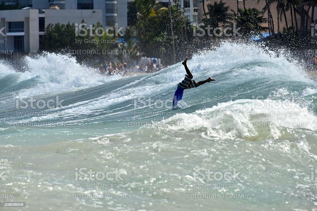 Surfer crashing stock photo