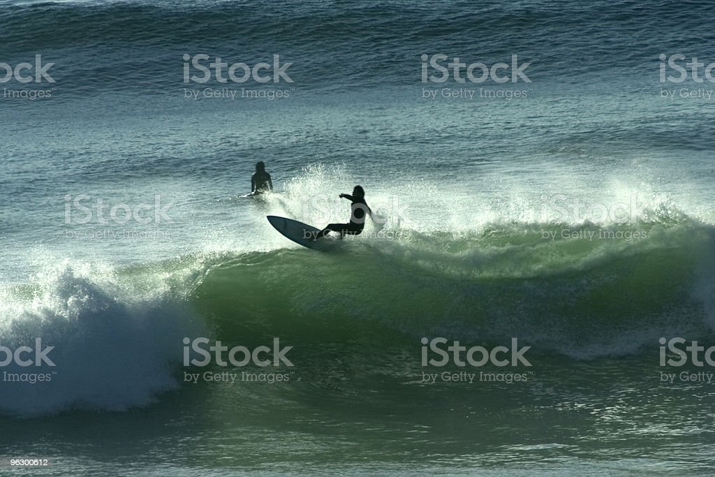 Surfer Cuts Back off Lip of Wave, Water Sports, Backlit royalty-free stock photo