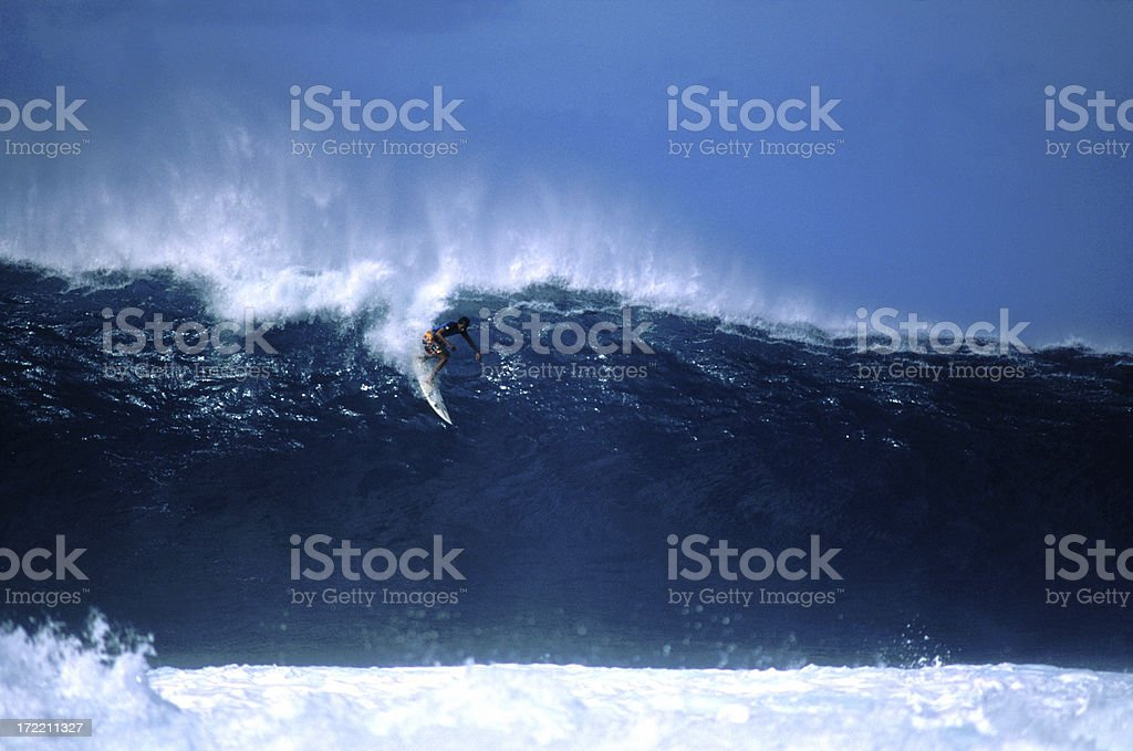 Surfer dropping in at big Pipeline, Hawaii stock photo