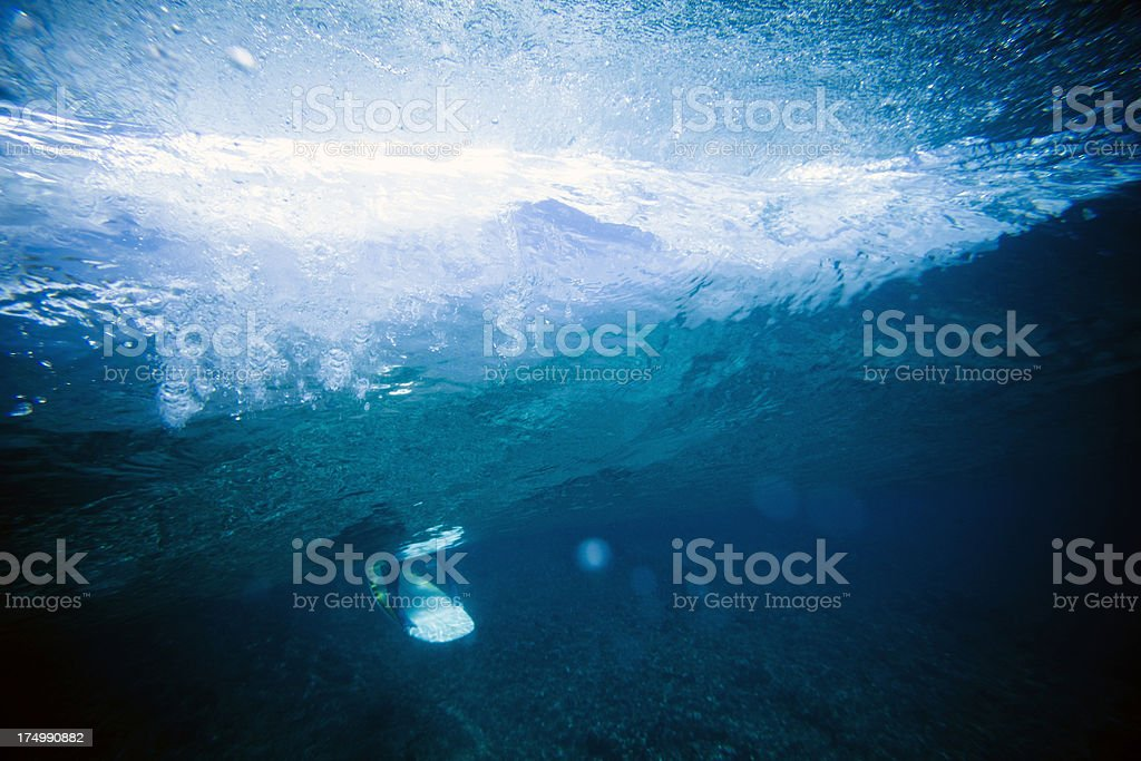 Surfer duck diving royalty-free stock photo