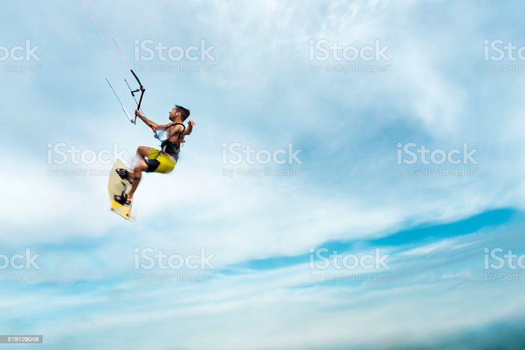 Surfer flying through the sky stock photo
