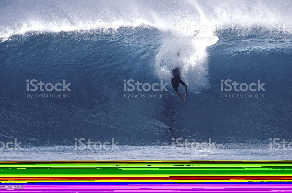 surfer getting barrelled royalty-free stock photo