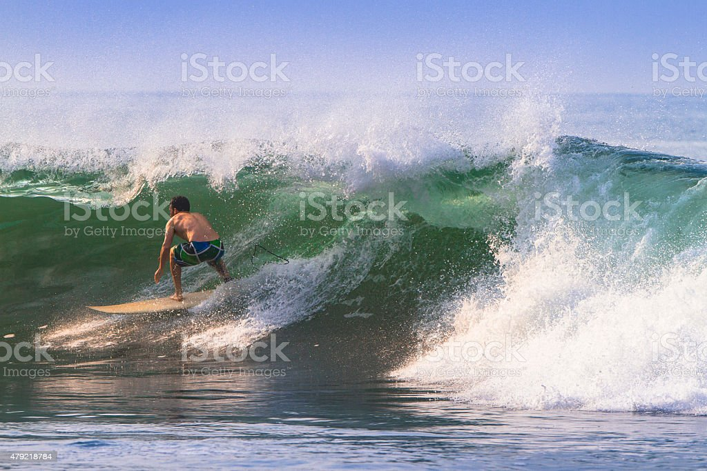 Surfer getting barrelled. stock photo