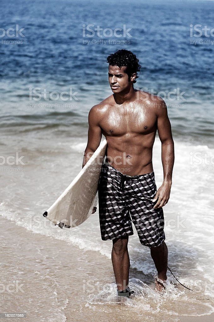 Surfer getting out of the sea royalty-free stock photo