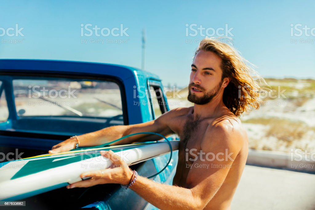 Surfer getting ready stock photo