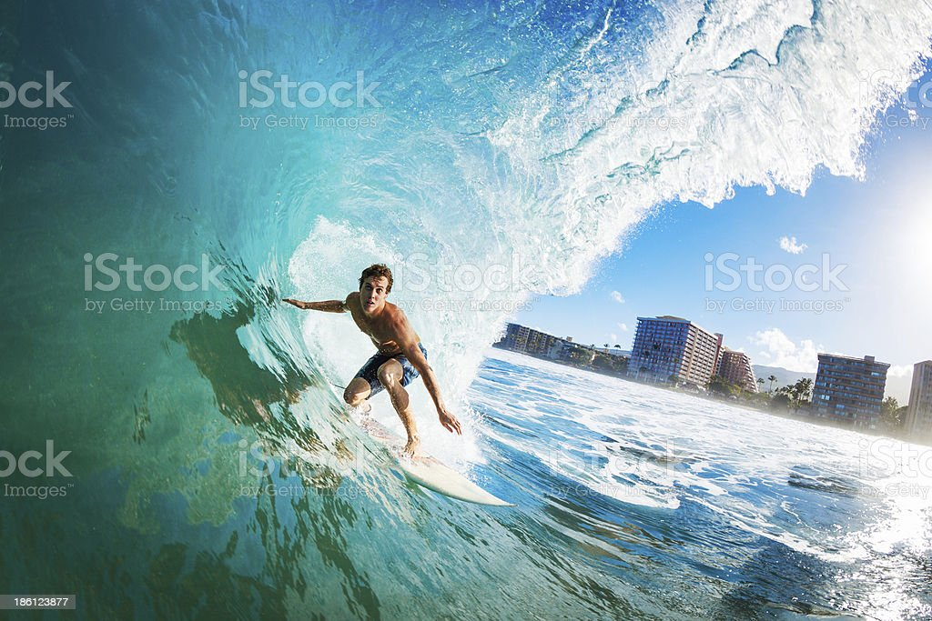 Surfer Gettting Barreled stock photo